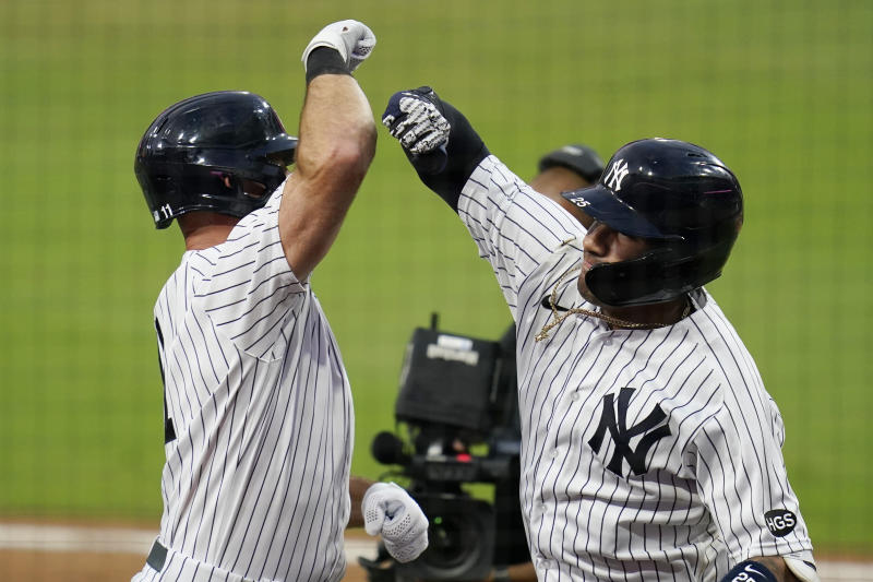 New York Yankees' Gleyber Torres, right, celebrates with Brett Gardner, left, after Torres hit a two-run home run in Game 4 of the ALDS. (AP Photo/Gregory Bull)