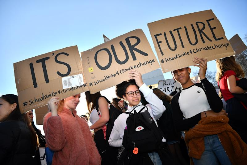 "Young demonstrators hold placards as they attend a climate change protest organised by ""Youth Strike 4 Climate"", opposite the Houses of Parliament in central London on February 15, 2019. - Hundreds of young people took to the streets to demonstrate Friday, with some of them having gone on strike from school, as part of a global youth action over climate change. (Photo by Ben STANSALL / AFP) (Photo credit should read BEN STANSALL/AFP/Getty Images)"
