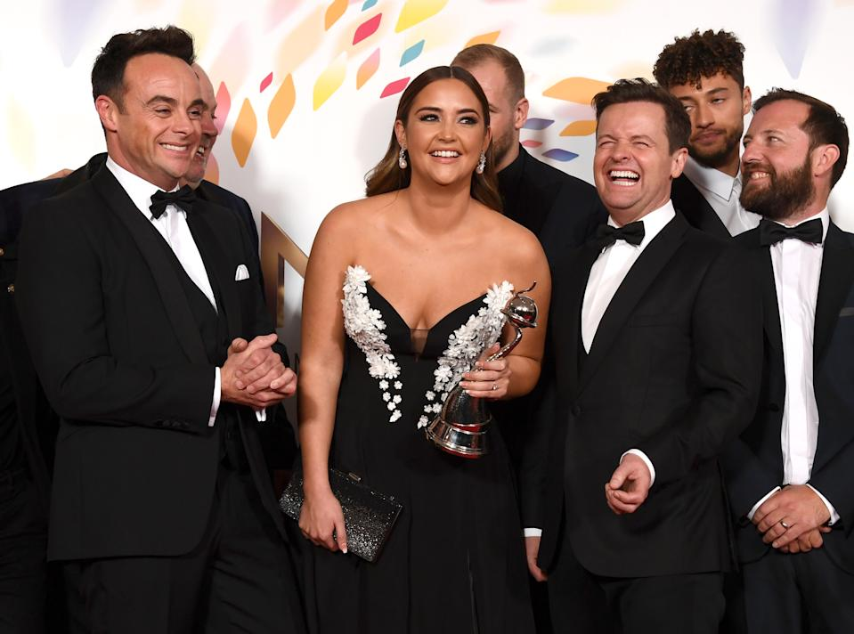 """LONDON, ENGLAND - JANUARY 28: Anthony McPartlin, Jacqueline Jossa and Declan Donnelly accepting the The Bruce Forsyth Entertainment Award for """"I'm A Celebrity... Get Me Out Of Here!"""", pose in the winners room during the National Television Awards 2020 at The O2 Arena on January 28, 2020 in London, England. (Photo by Gareth Cattermole/Getty Images)"""