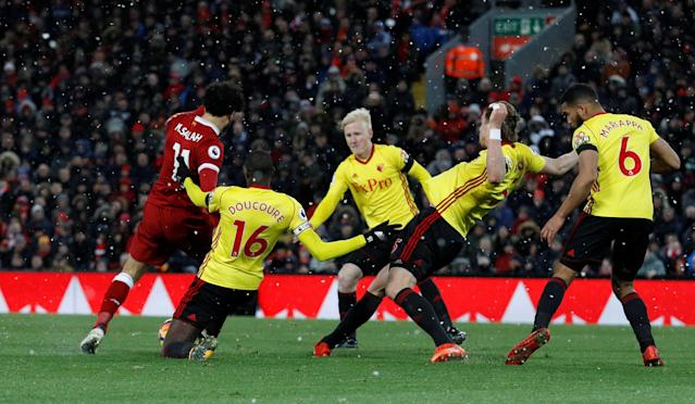 "Soccer Football - Premier League - Liverpool vs Watford - Anfield, Liverpool, Britain - March 17, 2018 Liverpool's Mohamed Salah scores their fourth goal REUTERS/Phil Noble EDITORIAL USE ONLY. No use with unauthorized audio, video, data, fixture lists, club/league logos or ""live"" services. Online in-match use limited to 75 images, no video emulation. No use in betting, games or single club/league/player publications. Please contact your account representative for further details."
