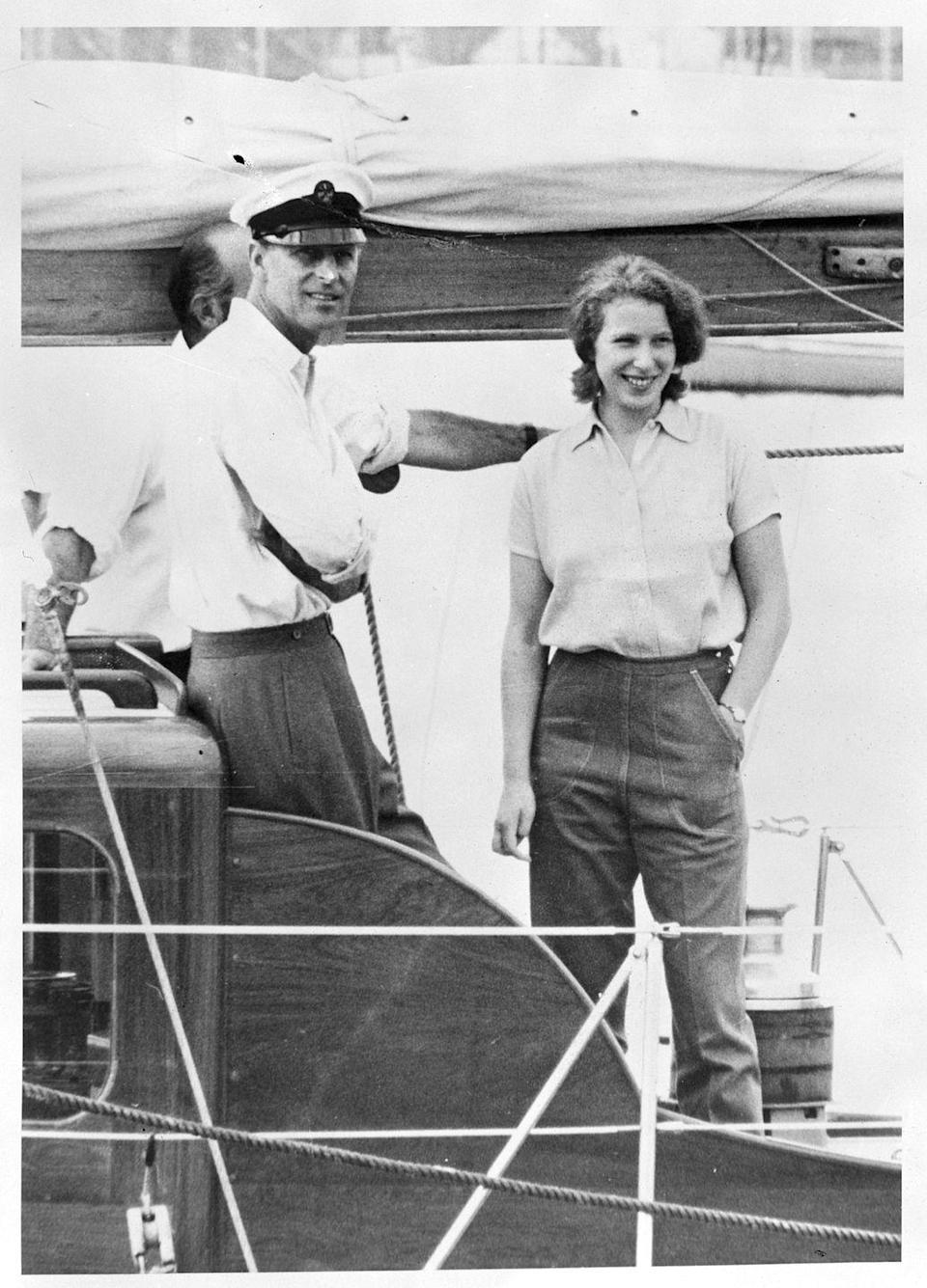 <p>Princess Anne on a boat with her father, Prince Philip.</p>