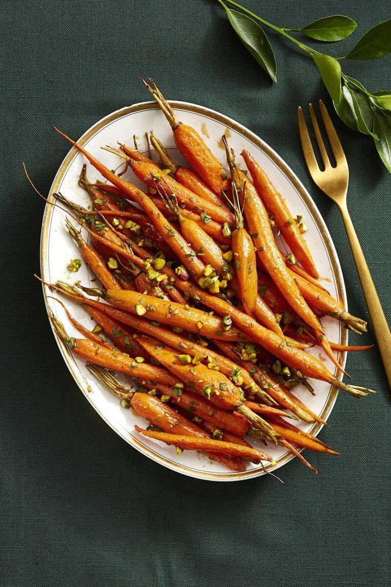 """<p>Paprika, nutmeg, and chopped pistachios spice-up this traditional holiday side.</p><p><em><a href=""""https://www.goodhousekeeping.com/food-recipes/a14891/spice-roasted-carrots-recipe-ghk1114/"""" rel=""""nofollow noopener"""" target=""""_blank"""" data-ylk=""""slk:Get the recipe for Spice-Roasted Carrots »"""" class=""""link rapid-noclick-resp"""">Get the recipe for Spice-Roasted Carrots »</a></em></p>"""