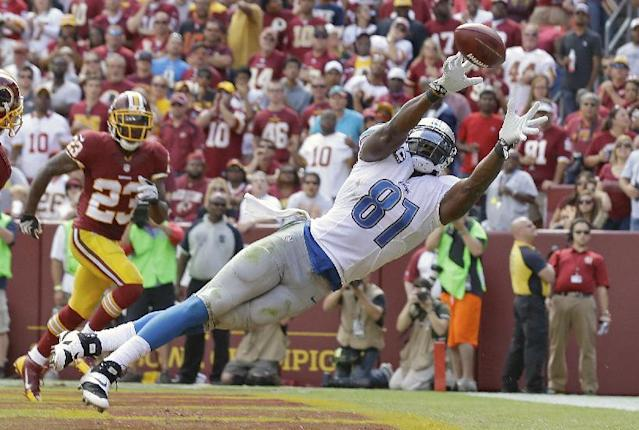Detroit Lions tight end Brandon Pettigrew can't quite reach a Matthew Stafford pass in the end zone as Washington Redskins cornerback DeAngelo Hall watches in the background during the first half of a NFL football game in Landover, Md., Sunday, Sept. 22, 2013. (AP Photo/Alex Brandon)
