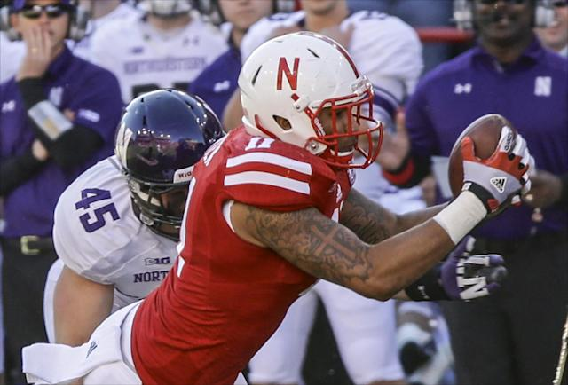 Nebraska tight end Cethan Carter (11) can't hold on to a pass from quarterback Tommy Armstorng Jr., against Northwestern linebacker Collin Ellis (45), in the first half of an NCAA college football game in Lincoln, Neb., Saturday, Nov. 2, 2013. (AP Photo/Nati Harnik)