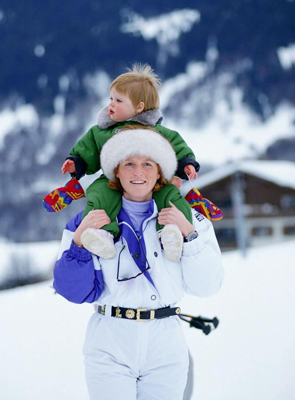 <p>Eugenie sits on her mom's shoulders during a ski vacation in Switzerland.</p>