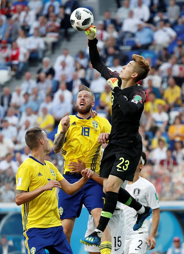 Soccer Football - World Cup - Group F - Sweden vs South Korea - Nizhny Novgorod Stadium, Nizhny Novgorod, Russia - June 18, 2018 South Korea's Cho Hyun-woo punches the ball as he is in action with Sweden's Pontus Jansson REUTERS/Murad Sezer