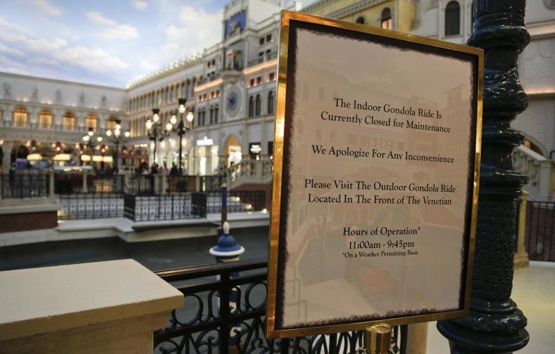 A sign posted at St. Mark's Square at the Venetian hotel-casino notifies visitors of the reason for the drained canals, Thursday, Sept. 19, 2013, in Las Vegas. Management has closed the waterways for several weeks for maintenance. (AP Photo/Julie Jacobson)