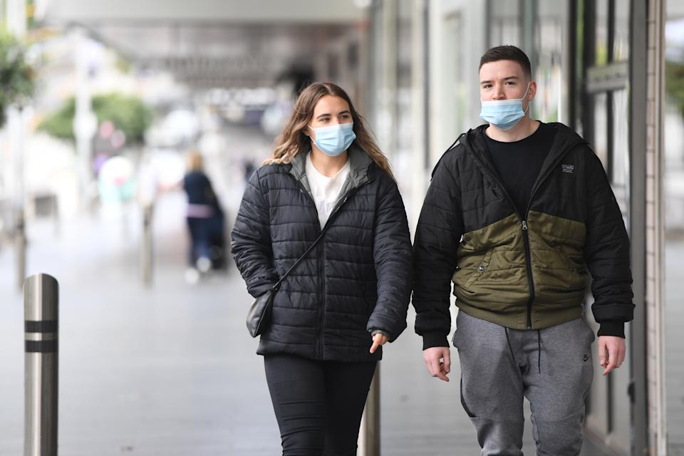 People are seen wearing masks in Melbourne.