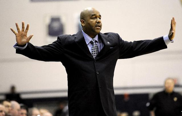 Georgetown head coach John Thompson III gestures during the first half of an NCAA college NIT tournament first round basketball game against West Virginia, Tuesday, March 18, 2014, in Washington. Georgetown won 77-65. (AP Photo/Nick Wass)