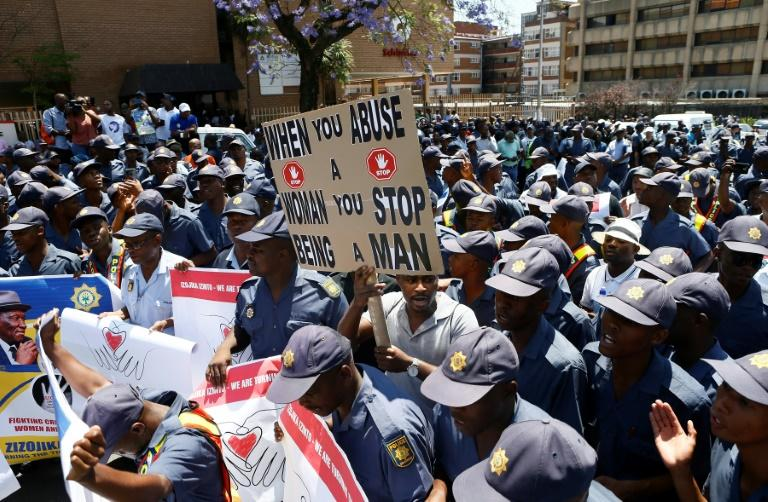 Hundreds of police joined the protest movement (AFP Photo/Phill Magakoe)