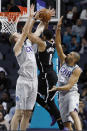 Charlotte Hornets' Cody Zeller (40) and Nicolas Batum (5) team up to try and stop Brooklyn Nets' Spencer Dinwiddie (8) on his way to the basket during the second half of an NBA basketball game in Charlotte, N.C., Friday, Dec. 6, 2019. The Nets won 111-104. (AP Photo/Bob Leverone)