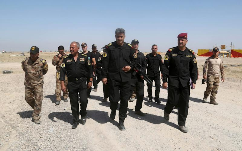 Lt. General Abdul-Wahab al-Saadi (C) is an extremely popular figure in Iraqi politicsfor his work in the fight against Islamic State - Khalid Mohammed/AP