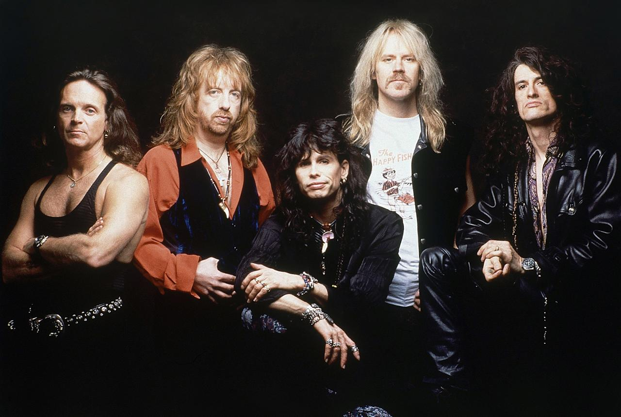 "Aerosmith After considering names like ""The Hookers"" and ""Spike Jones,"" drummer Joey Kramer told the band in high school he wrote the word ""Aerosmith"" all over his notebooks. Apparently the name came to him after listening to Harry Nilsson's Aerial Ballet album, whose cover art has an image of a circus performer jumping out of a biplane."