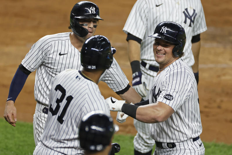 New York Yankees' Luke Voit celebrates hitting a three-run home run during the second inning of a baseball game against the Toronto Blue Jays on Tuesday, Sept. 15, 2020, in New York. (AP Photo/Adam Hunger)
