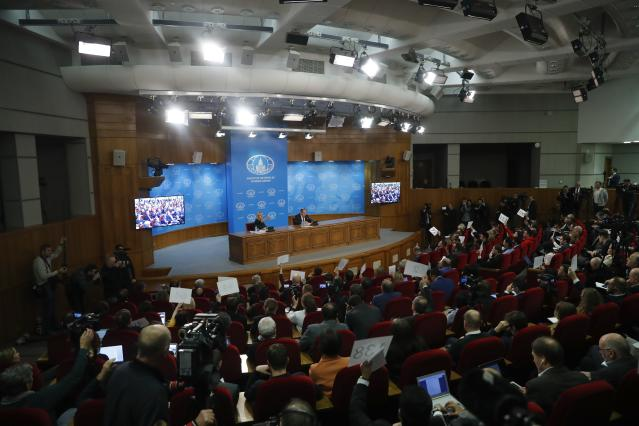 Foreign Ministry spokesperson Maria Zakharova, center left, gestures as Russian Foreign Minister Sergey Lavrov, center right, speaks about his department's 2018 accomplishments during his annual roundup news conference in Moscow, Russia, Wednesday, Jan. 16, 2019. (AP Photo/Pavel Golovkin)