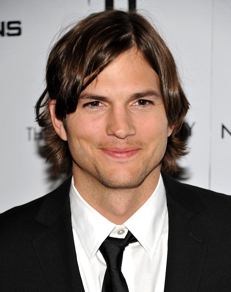 "FILE - In this Jan. 20, 2011 file photo, actor Ashton Kutcher attends a special screening of ""No Strings Attached"" in New York. Kutcher will play ""an Internet billionaire with a broken heart"" when he arrives as the new star of ""Two and a Half Men"" next month. Kutcher's character will be named Walden Schmidt and has no family connection to the characters played by continuing stars Jon Cryer and Angus T. Jones, who portrayed the brother and nephew of Sheen's departed character.  (AP Photo/Evan Agostini, File)"