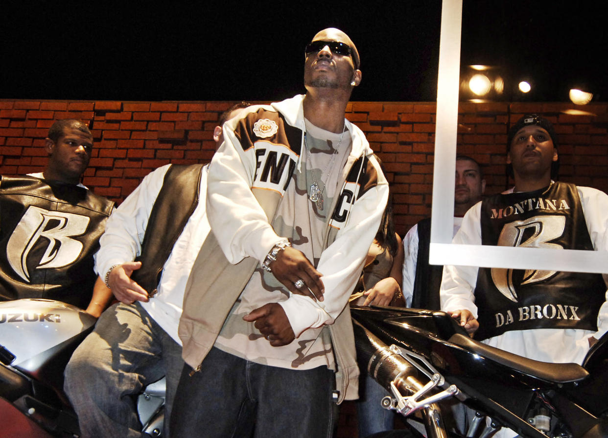 """FILE - DMX, whose real name is Earl Simmons, performs following the announcement of his record label change to Sony Music in New York on Jan. 13, 2006. The family of rapper DMX says he has died at age 50 after a career in which he delivered iconic hip-hop songs such as """"Ruff Ryders' Anthem."""