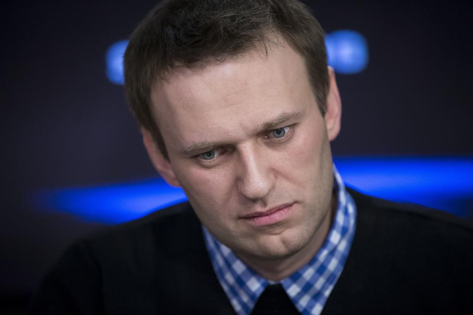 FILE - In this Monday, April 8, 2013 file photo, Russian opposition leader Alexei Navalny listens to a question during an interview at the Echo Moskvy (Echo of Moscow) radio station in Moscow. Navalny's energy and charisma propelled him from a lonely role blogging about corruption to widely renown as Russia's leading opposition activist. His projects, including a campaign to run for Moscow mayor, have attracted hordes of volunteers and fundraisers. Now comes a day that looms large for Navalny and the opposition: A court hands down its verdict Thursday in an embezzlement case that could send him to prison for six years. (AP Photo/Alexander Zemlianichenko, File)