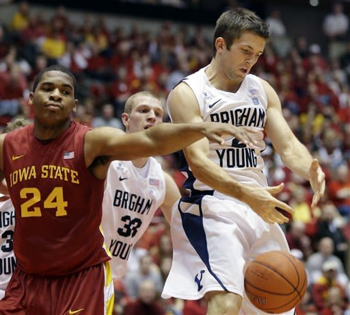 Iowa State center Percy Gibson, left, fights for a rebound with Brigham Young guard Craig Cusick, right, during the first half of an NCAA college basketball game, Saturday, Dec. 1, 2012, in Ames, Iowa. (AP Photo/Charlie Neibergall)