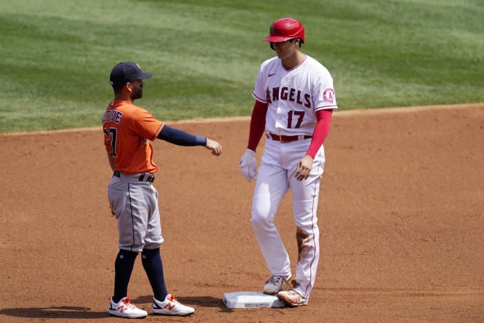 Los Angeles Angels' Shohei Ohtani, right, talks to Houston Astros second baseman Jose Altuve after stealing second during the first inning of a baseball game Tuesday, April 6, 2021, in Anaheim, Calif. (AP Photo/Mark J. Terrill)