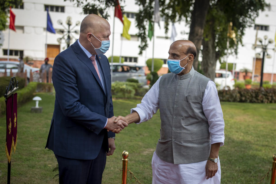 Indian Defense Minister Rajnath Singh, right, welcomes his Australian counterpart Peter Dutton as he arrives for a Guard of Honor in New Delhi, India, Friday, Sept. 10, 2021. (AP Photo/Altaf Qadri)