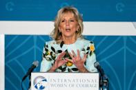 """<p>On March 8, 2021 Dr. Jill Biden took the podium at the International Women of Courage Award virtual ceremony in Washington, DC wearing the same exact <a href=""""https://www.popsugar.com/fashion/jill-biden-oscar-de-la-renta-lemon-dress-48204808"""" class=""""link rapid-noclick-resp"""" rel=""""nofollow noopener"""" target=""""_blank"""" data-ylk=""""slk:lemon print from Oscar de la Renta"""">lemon print from Oscar de la Renta</a> that <a class=""""link rapid-noclick-resp"""" href=""""https://www.popsugar.com/Meghan-Markle"""" rel=""""nofollow noopener"""" target=""""_blank"""" data-ylk=""""slk:Meghan Markle"""">Meghan Markle</a> wore two weeks prior. It could have been a public sign of support for the Duchess of Sussex, who took a stand for herself, and for others struggling with their mental health, during her <a href=""""https://www.popsugar.com/fashion/meghan-markle-oprah-interview-dress-meaning-48203918"""" class=""""link rapid-noclick-resp"""" rel=""""nofollow noopener"""" target=""""_blank"""" data-ylk=""""slk:interview with Oprah"""">interview with Oprah</a>. But Biden has also supported Oscar de la Renta before, which is currently led by emerging designers and immigrants to the US Laura Kim and Fernando Garcia. This look came complete with a matching face mask, a life-saving accessory Biden has always made sure to stress as an <a href=""""https://www.popsugar.com/fashion/jill-biden-floral-face-mask-dress-debate-47911366"""" class=""""link rapid-noclick-resp"""" rel=""""nofollow noopener"""" target=""""_blank"""" data-ylk=""""slk:integral part of her look"""">integral part of her look</a>.</p>"""
