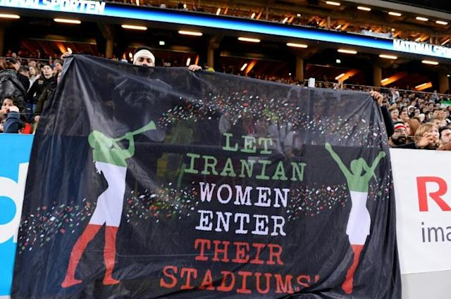 Supporters hold a banner calling for Iranian women to be allowed to enter football stadiums, during a match between Sweden and Iran near Stockholm in March 2015 (AFP Photo/JONATHAN NACKSTRAND)