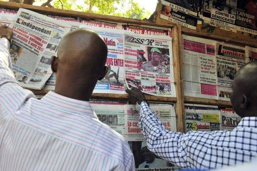 "<p>Locals read newspapers in Bamako on the situation in the north. The UN Security Council called for an immediate ceasefire and return to democracy in Mali, prompting an announcement of an end to ""military operations"" by Tuareg rebels in the north.</p>"