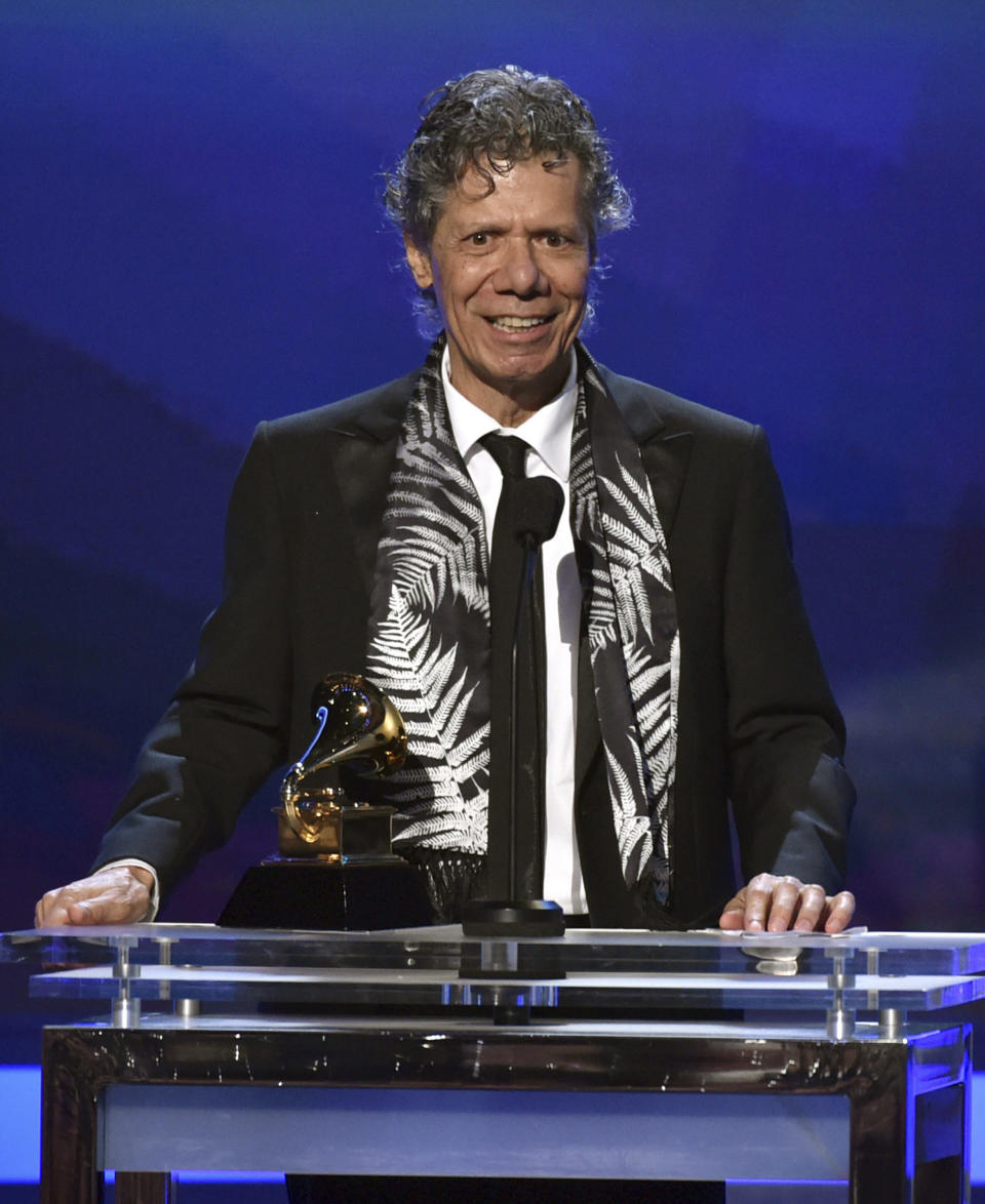 """FILE - Chick Corea accepts the award for best improvised jazz solo for """"Fingerprints"""" at the 57th annual Grammy Awards on Feb. 8, 2015, in Los Angeles. Corea, a towering jazz pianist with a staggering 23 Grammy awards who pushed the boundaries of the genre and worked alongside Miles Davis and Herbie Hancock, has died. He was 79. Corea died Tuesday, Feb. 9, 2021, of a rare for of cancer, his team posted on his web site. His death was confirmed by Corea's web and marketing manager, Dan Muse. (Photo by John Shearer/Invision/AP, File)"""