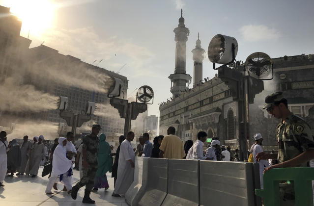 <p>Large cooling fans spray water on Muslim pilgrims around the Grand Mosque ahead of the annual Hajj pilgrimage in the Muslim holy city of Mecca, Saudi Arabia, Tuesday, Aug. 29, 2017. (Photo: Khalil Hamra/AP) </p>