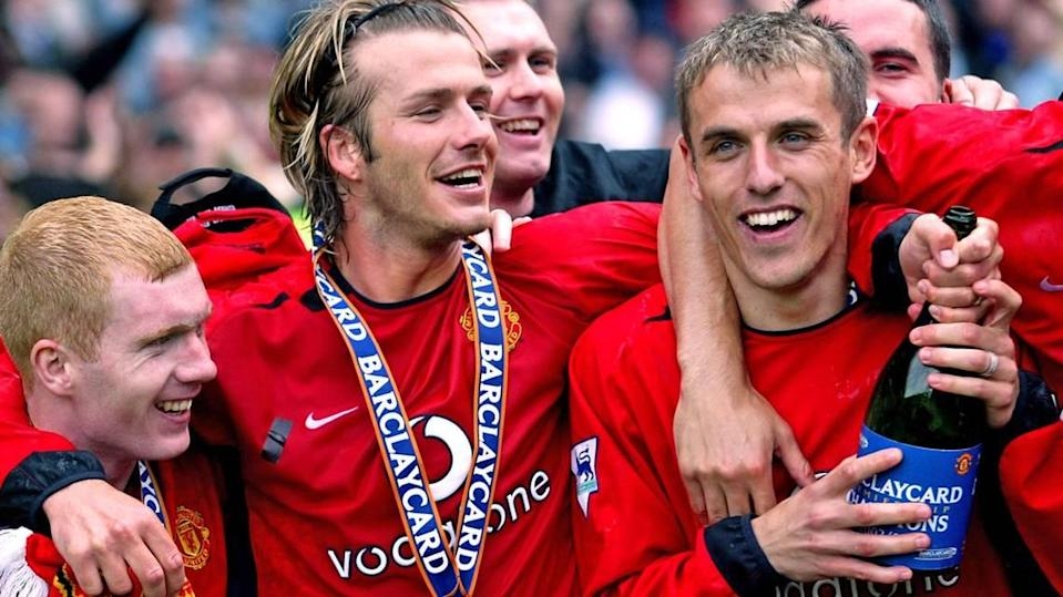 David Beckham (middle) and Phil Neville (right) celebrate Manchester United's Premiership trophy in 2003. They will be reunited at Inter Miami -- Beckham is co-owner and hiring Neville to become team's new coach for 2021.