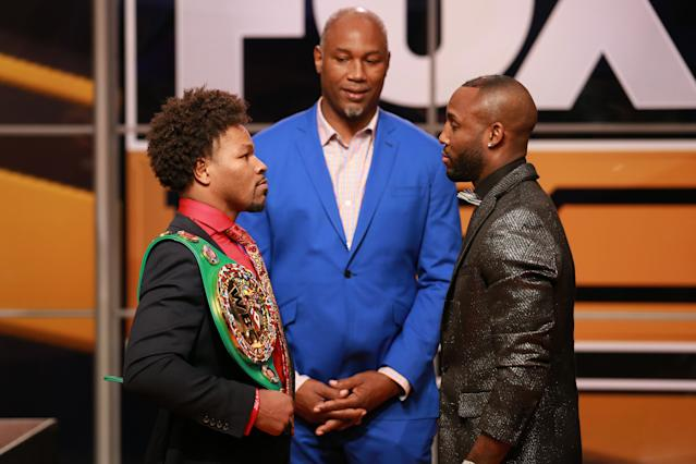 Shawn Porter (L) goes face-to-face with Yordenis Ugas at a news conference on Nov. 13, 2018 in Los Angeles. (Getty Images)
