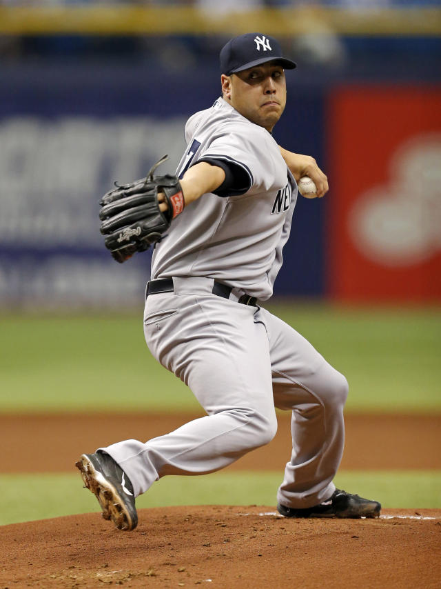 New York Yankees starting pitcher Vidal Nuno throws during the first inning of a baseball game against the Tampa Bay Rays, Sunday, April 20, 2014, in St. Petersburg, Fla. (AP Photo/Mike Carlson)