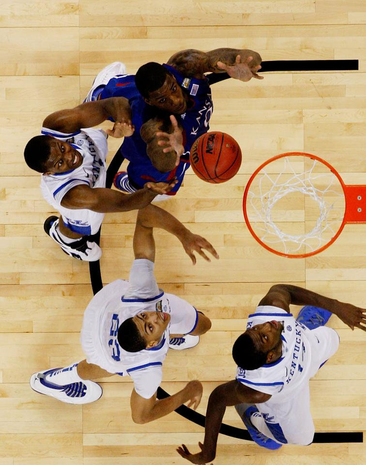 Thomas Robinson #0 of the Kansas Jayhawks goes up for a shot against Darius Miller #1 of the Kentucky Wildcats in the first half in the National Championship Game of the 2012 NCAA Division I Men's Basketball Tournament at the Mercedes-Benz Superdome on April 2, 2012 in New Orleans, Louisiana. (Photo by Chris Graythen/Getty Images)