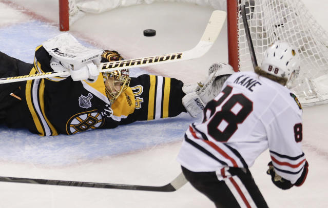 Chicago Blackhawks right wing Patrick Kane (88) scores past Boston Bruins goalie Tuukka Rask (40), of Finland, during the second period in Game 4 of the NHL hockey Stanley Cup Finals, Wednesday, June 19, 2013, in Boston. (AP Photo/Charles Krupa)