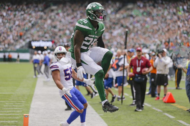 New York Jets running back Le'Veon Bell celebrates his first touchdown with his new team. (AP)