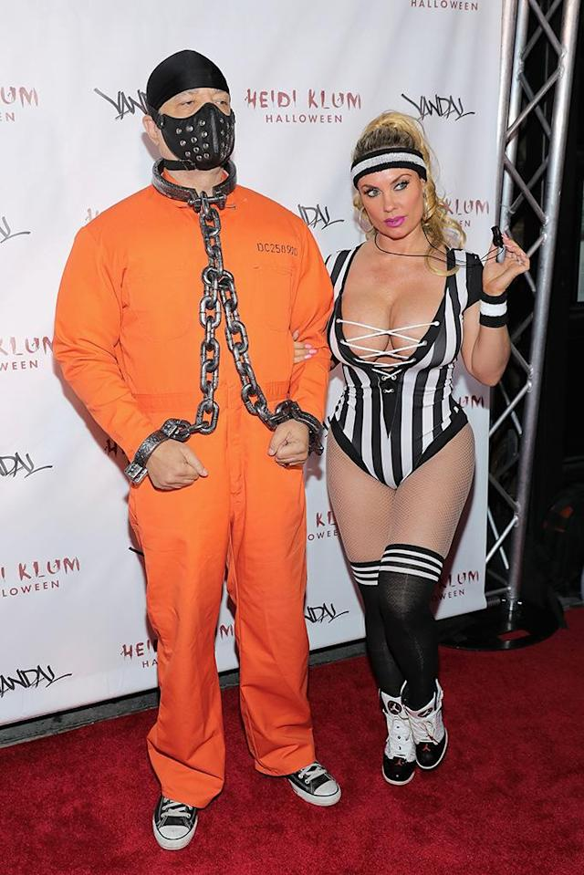 <p>This husband and wife duo always do it up big, so it's no surprise their take on the convict look would be over the top. (Photo: Neilson Barnard/Getty Images for Heidi Klum) </p>