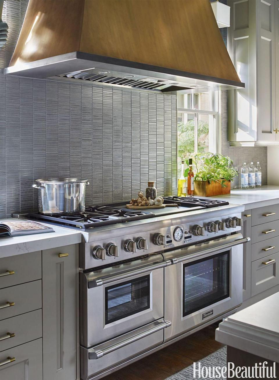 """<p>Though some kitchens go smaller, others go bigger with massive cooking ranges (and hoods to go with them), like what was in our 2016 Kitchen of the Year. </p><p><a href=""""http://www.housebeautiful.com/room-decorating/kitchens/g3775/2016-kitchen-of-the-year/?slide=3"""" rel=""""nofollow noopener"""" target=""""_blank"""" data-ylk=""""slk:See more of the 2016 Kitchen of the Year »"""" class=""""link rapid-noclick-resp""""><em>See more of the 2016 Kitchen of the Year »</em></a></p>"""