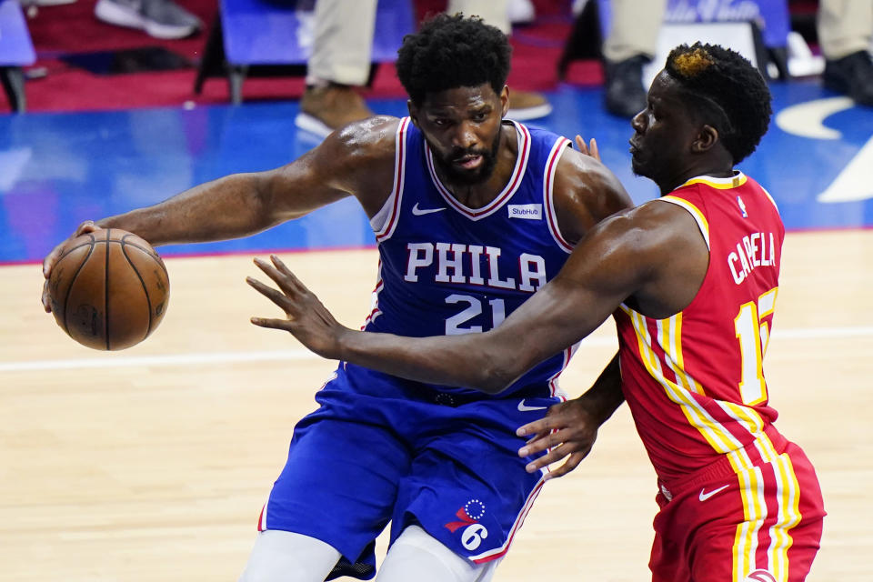 Philadelphia 76ers' Joel Embiid, left, tries to get past Atlanta Hawks' Clint Capela during the first half of Game 2 in a second-round NBA basketball playoff series, Tuesday, June 8, 2021, in Philadelphia. (AP Photo/Matt Slocum)