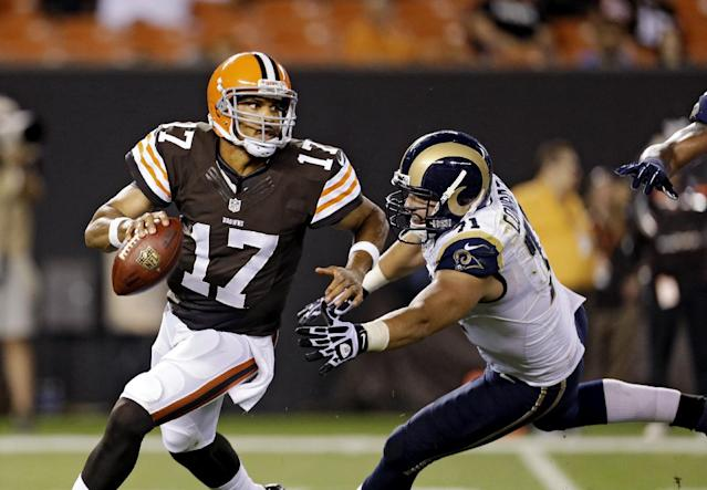 FILE - In this Aug. 8, 2013 file photo, Cleveland Browns quarterback Jason Campbell (17) is chased by St. Louis Rams' Matt Conrath in the second quarter of a preseason NFL football game, in Cleveland. Browns backup quarterback Jason Campbell will replace struggling Brandon Weeden and start on Sunday in Kansas City. (AP Photo/Tony Dejak, File)