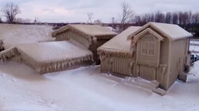 Residents brace for big melt after their homes encased in ice