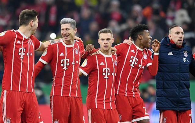 (From L) Bayern Munich's Niklas Suele, Robert Lewandowski, Joshua Kimmich, David Alaba and Franck Ribery react at the end of their German Cup DFB Pokal match against Borussia Dortmund, in Munich, on December 20, 2017 (AFP Photo/Tobias Hase)