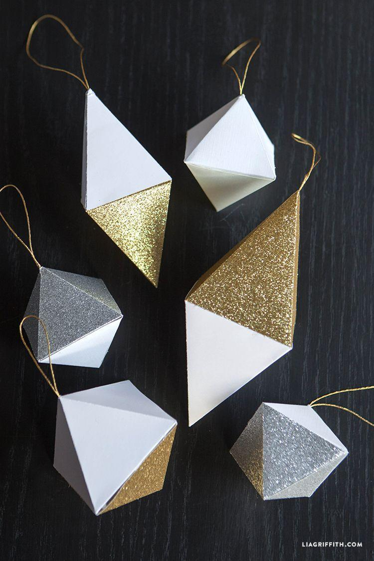 """<p>These are made entirely out of paper. Yes, we know, shocking but true! They're perfect if you're going for a glittery gold, silver, white, and black aesthetic.</p><p>Get the tutorial at <a href=""""https://liagriffith.com/paper-geode-christmas-ornaments/"""" rel=""""nofollow noopener"""" target=""""_blank"""" data-ylk=""""slk:Lia Griffith"""" class=""""link rapid-noclick-resp"""">Lia Griffith</a>.</p>"""
