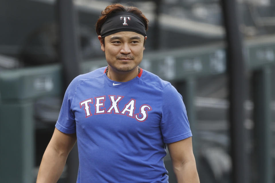 FILE - In this Aug. 14, 2020, file photo, Texas Rangers outfielder Shin-Soo Choo warms up before a baseball game against the Colorado Rockies in Denver. Free agent Choo has agreed to a one-year contract to play for a baseball club in his native South Korea. Choo, who spent the last seven seasons with the Texas Rangers, signed a 2.7 billion won ($2.4 million) deal with a Korean Baseball Organization team owned by an affiliate with the Shinsegae business group, the company said in a statement Thursday, Feb. 25, 2021. (AP Photo/David Zalubowski, File)