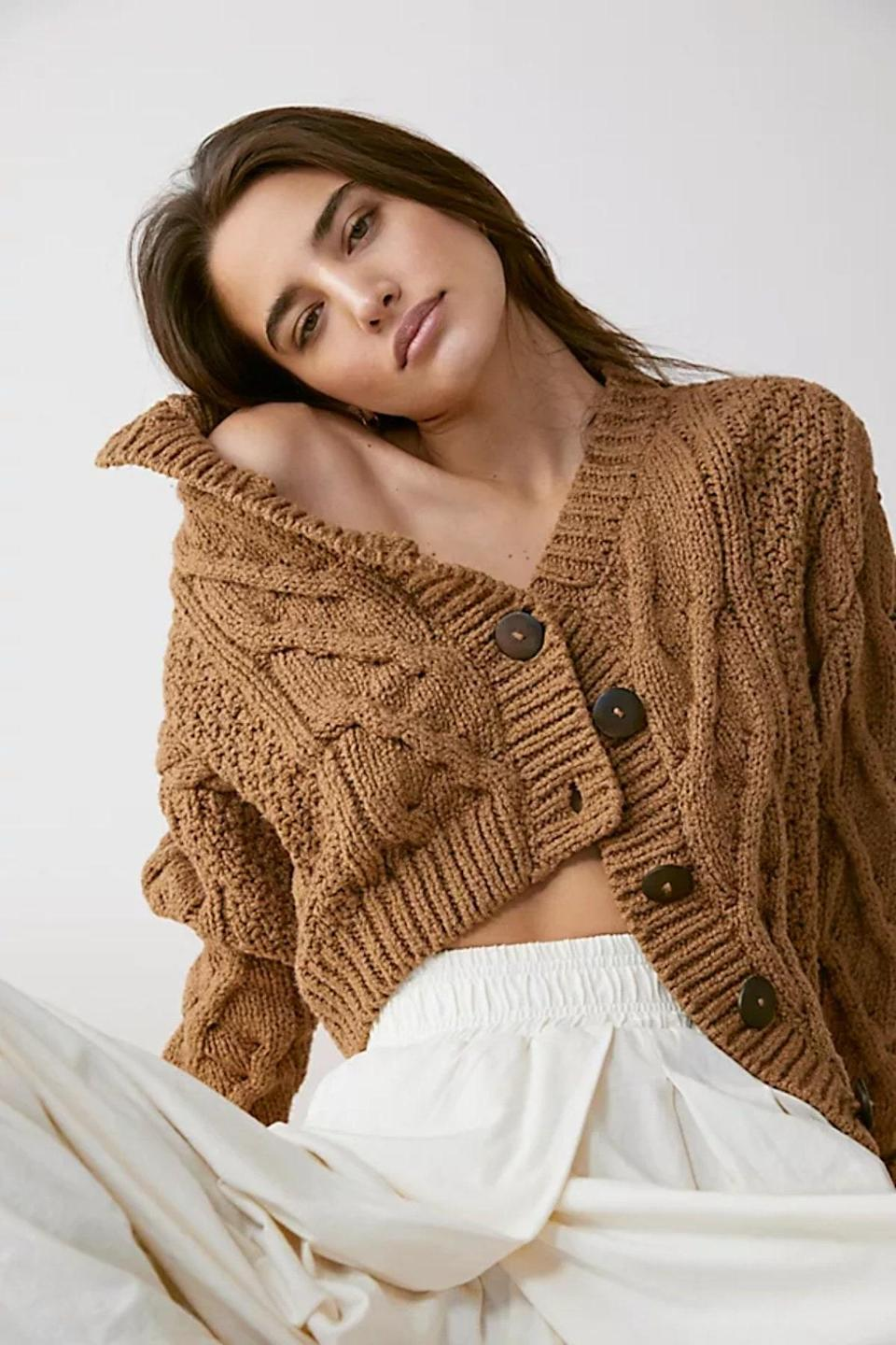 """There's no way around it: Free People has mastered the art of the """"slouch,"""" as evidenced by this relaxed caramel cardigan that you can throw over just about any dress or bottom in your wardrobe. $148, Free People. <a href=""""https://www.freepeople.com/shop/bonfire-cardi/?category=sweaters&color=023&type=REGULAR&quantity=1"""" rel=""""nofollow noopener"""" target=""""_blank"""" data-ylk=""""slk:Get it now!"""" class=""""link rapid-noclick-resp"""">Get it now!</a>"""