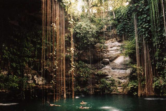Ik Kil Cenote. Photo: Alba Vales - Decorated with waterfalls and hanging vines, it is inhabited by black catfish and is home to a resounding echo. A staircase takes you down to the swimming hole, which is a popular spot for snorkelling.
