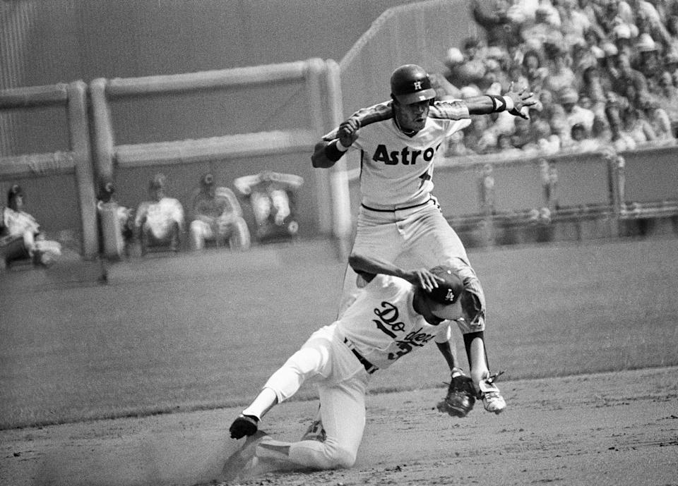 Houston's Cesar Cedeno runs into and bumps Dodgers shortstop Derrel Thomas after successfully stealing second.