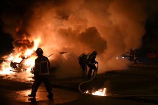Dozens of vehicles were set ablaze in a fourth night of rioting in western France after a policeman shot dead a young black man