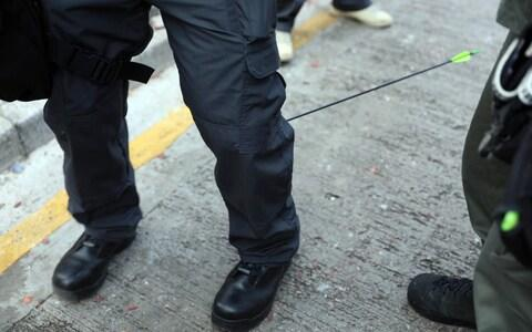 An officer was hit in the calf by an arrow fired by protesters outside the Polytechnic University of Hong Kong - Credit: EPA-EFE/REX/Hong Kong Police Force