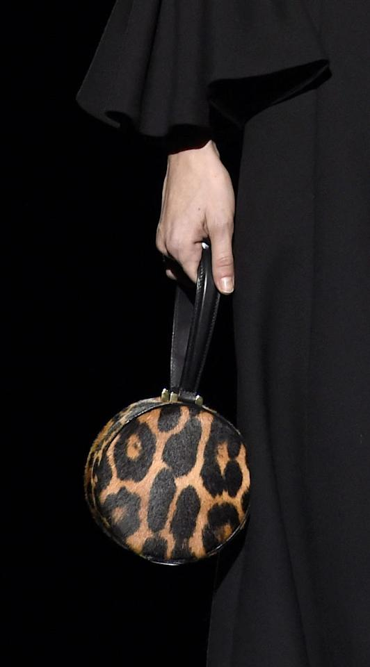 <p>Mini bags are a staple handbag. This mini round wristlet in a chic timeless leopard print is perfect for throwing in a few essentials and hitting the streets. </p>